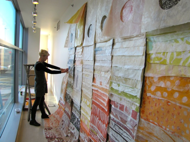Eva Isaksen installing her newest work in Chinatown
